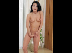 Sexy, black-haired vixen disrobes down..