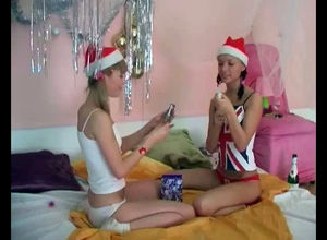 Teen lezzies  celebrating on the bed...