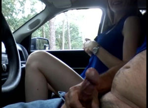 Nymph stroking a cab driver in the car