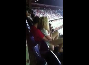 Public lovemaking in stadium during..
